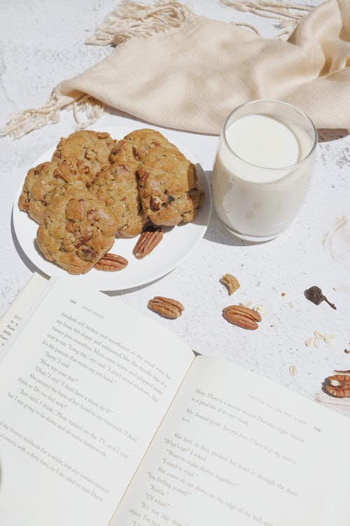 Cookies on Plate Beside a Glass of Milk