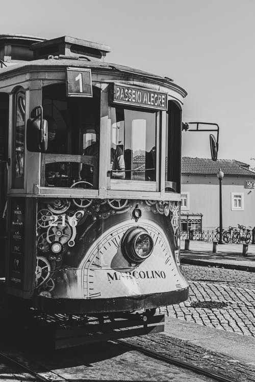 Grayscale Photo of Tram on Road
