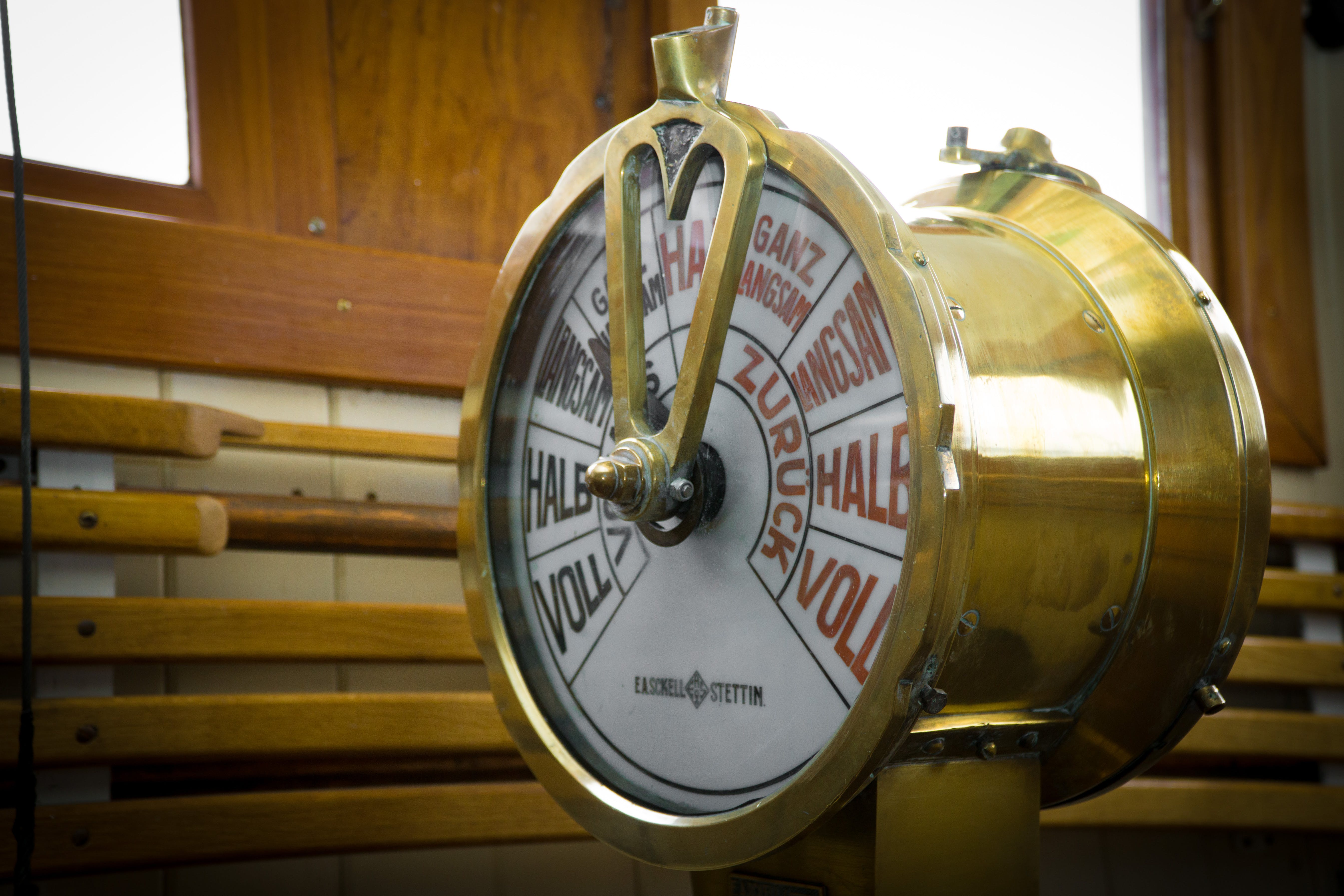 Close-up Photography of Round Brass-colored Ship Throttle Device