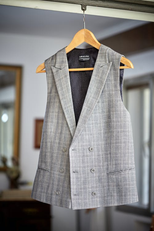 Gray Vest Hanging on a Hanger