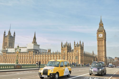 Yellow Taxi Cab on Road Near Big Ben