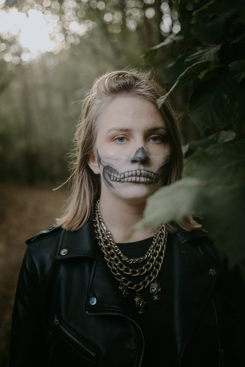 Woman in Black Leather Jacket With Silver Nose Ring