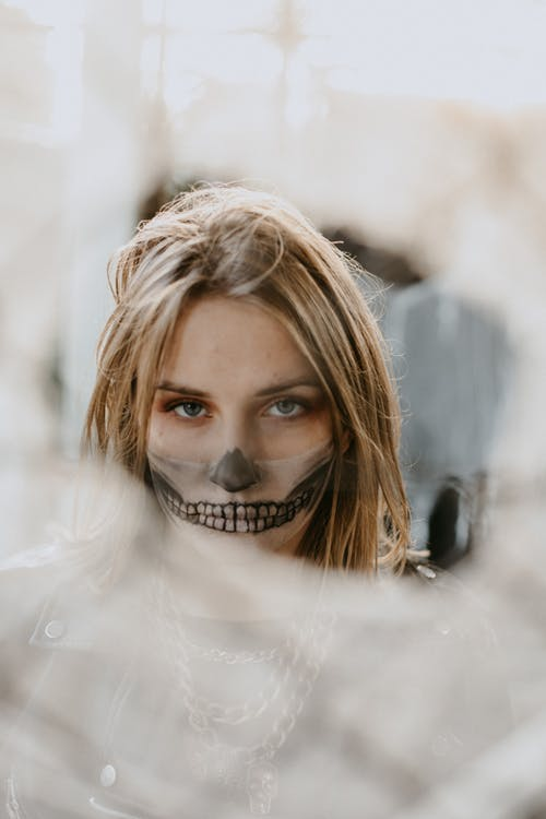 Young woman with scary Halloween makeup