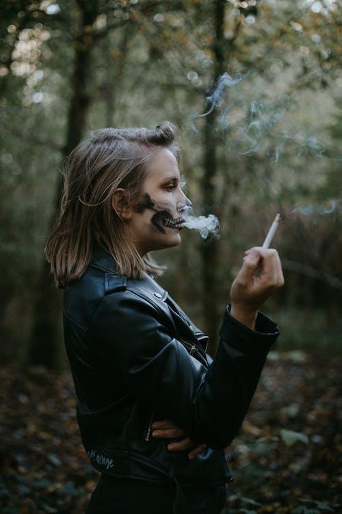 Woman in Black Leather Jacket Smoking