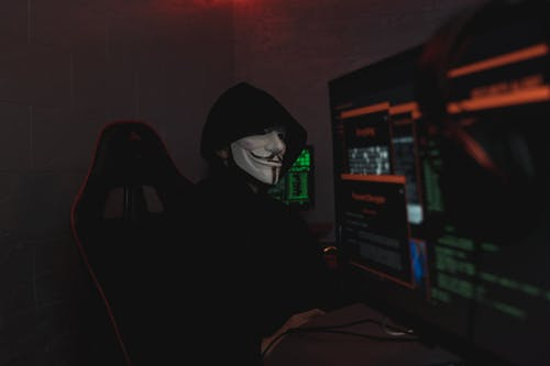 hackeamento de sistema, インドア, ガイフォークスマスクの無料の写真素材