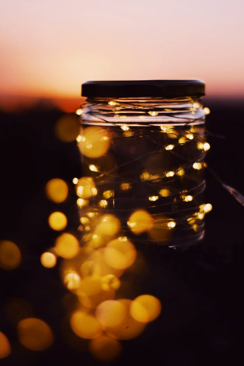 Close-Up View of a Clear Glass Jar With Yellow String Lights