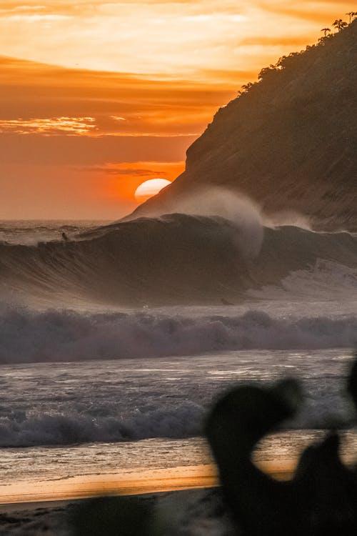 Big Sea Waves Crashing on the Seashore during Sunset