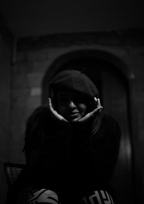 Grayscale Photo of Person in Black Hoodie