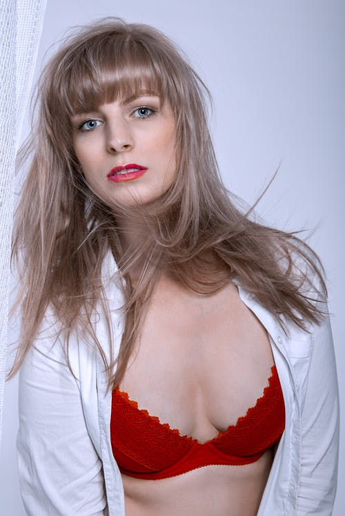 Woman in Red Lipstick and White Long Sleeve Shirt
