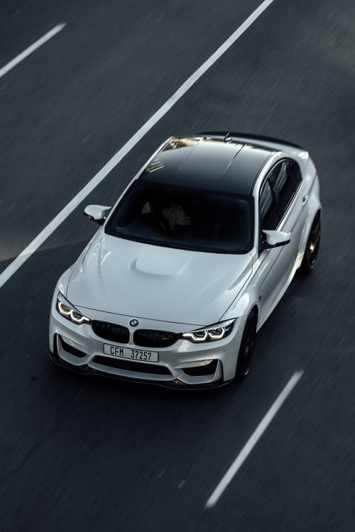 White BMW M3 Driving on the Road
