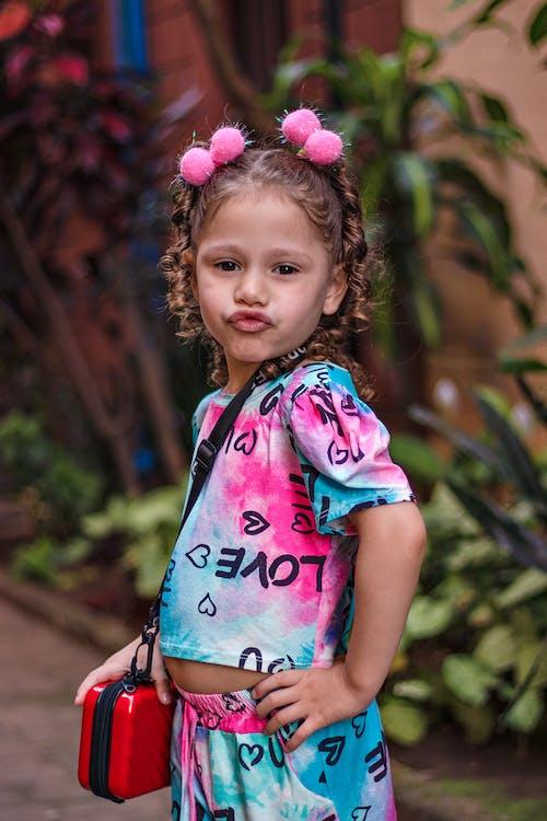 Adorable modish girl pouting lips