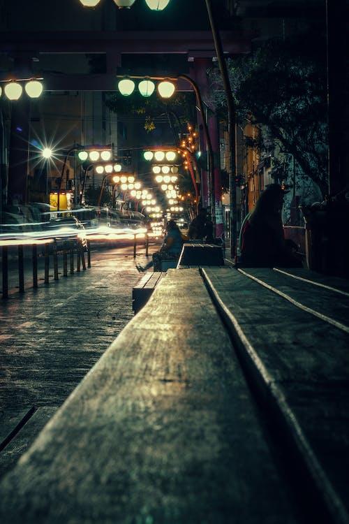 Illuminated city street at dark night time