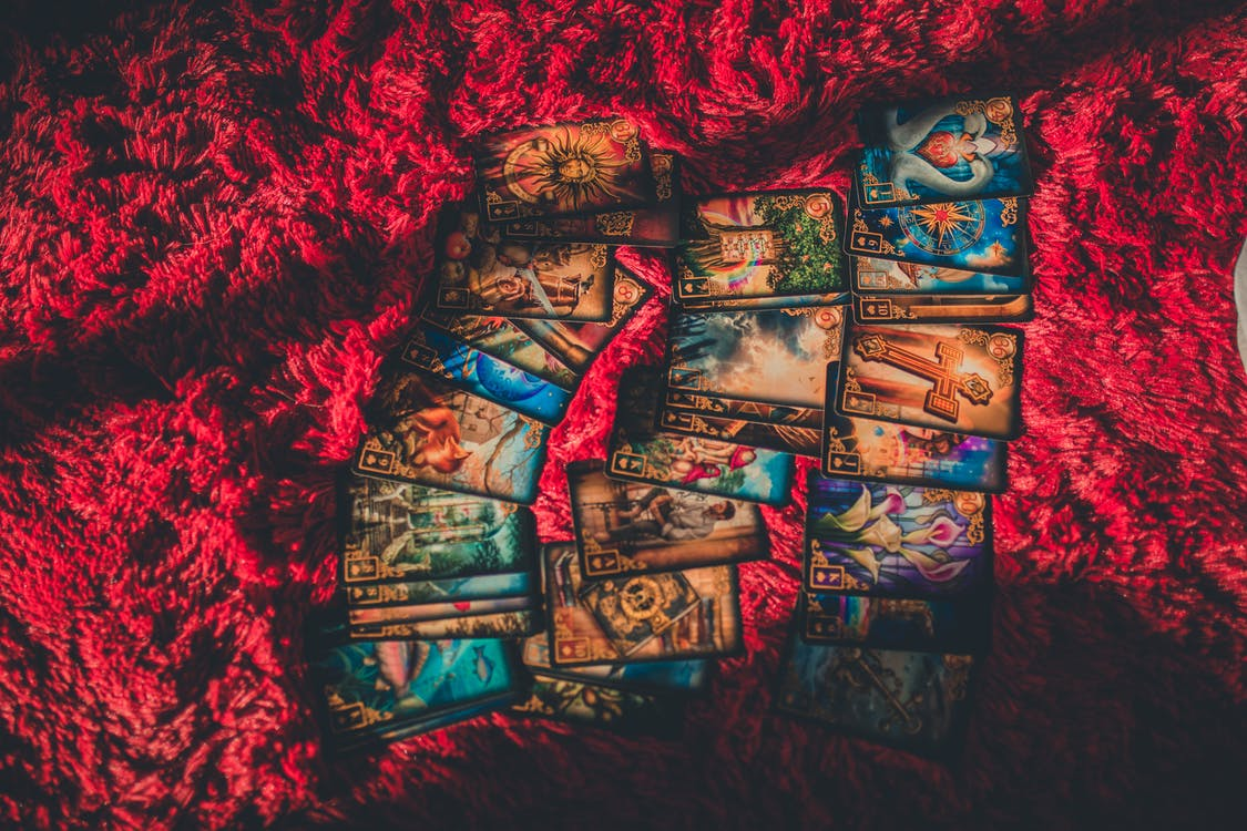 Tarot Cards Laid out on Red Fabric