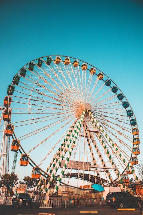 A Huge Ferris Wheel Under the Blue Sky