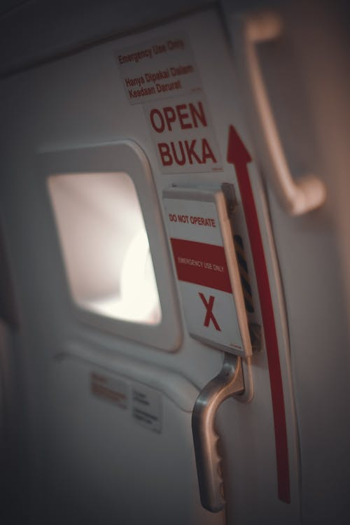 Airplane door with arrow and small illuminator