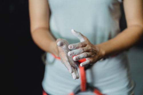Sportswoman with talc on hands