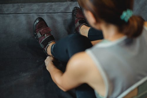 Woman preparing for training in fitness club