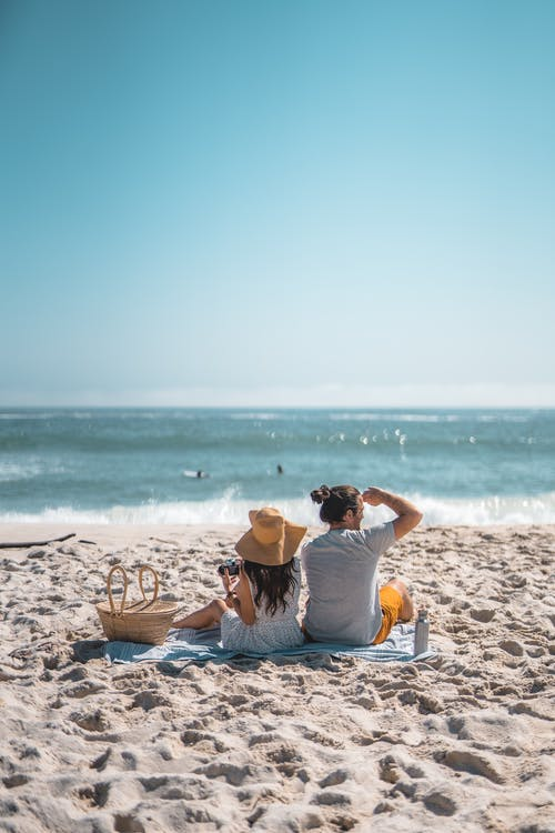 A Couple Relaxing at the Beach