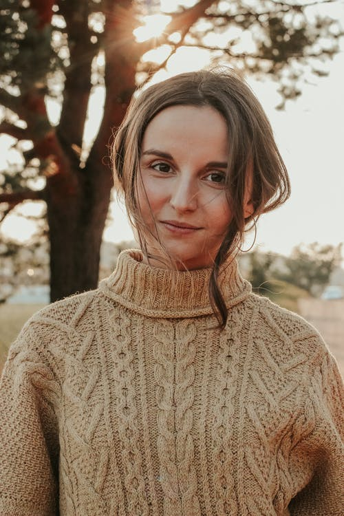 Woman in Beige Knit Sweater