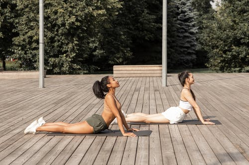 Relaxed women doing Bhujangasana pose