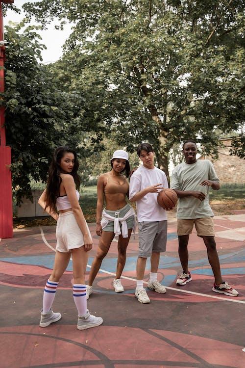 Stylish diverse friends on basketball court