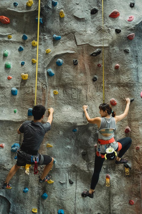 Alpinists training on climbing wall