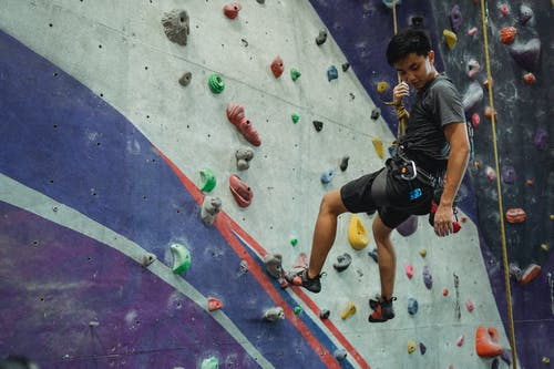 Alpinist training  in climbing gym