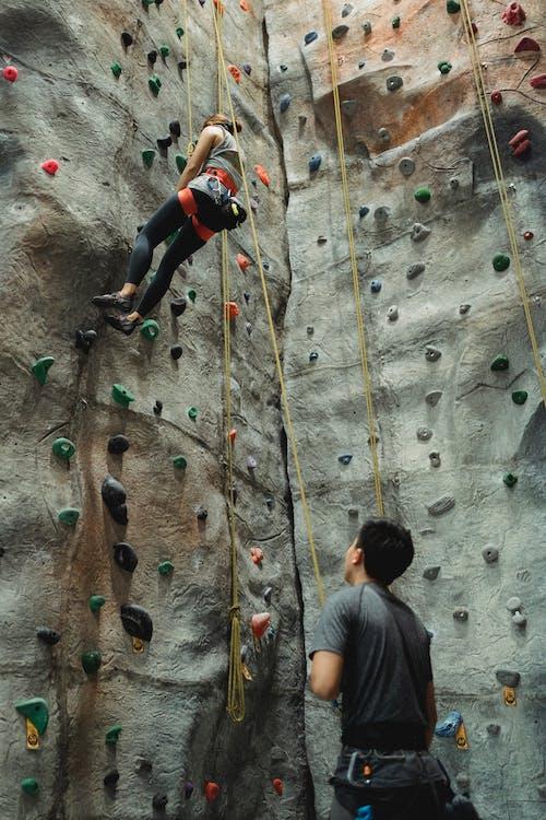 Climbers training on climbing wall
