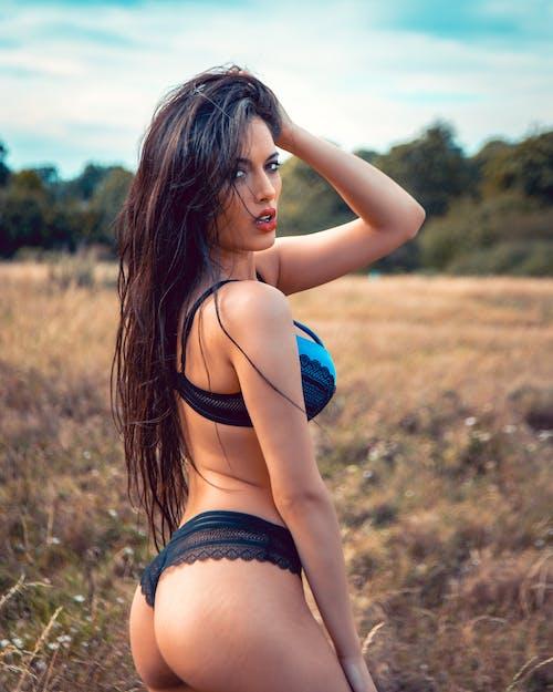 Woman in Blue and Black Bikini Bottom