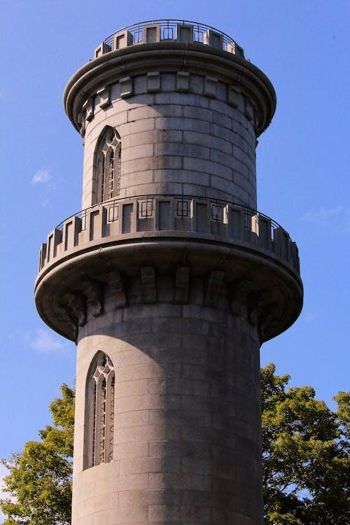 Gray Concrete Tower Under Blue Sky