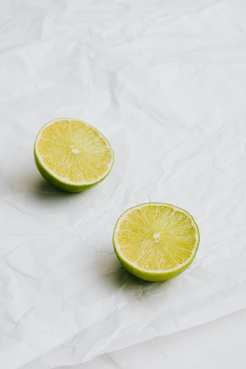 Sliced Lime on White Surface