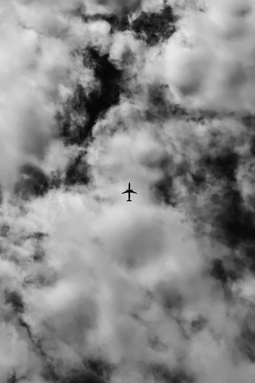 Grayscale Photo of an Airplane in the Sky