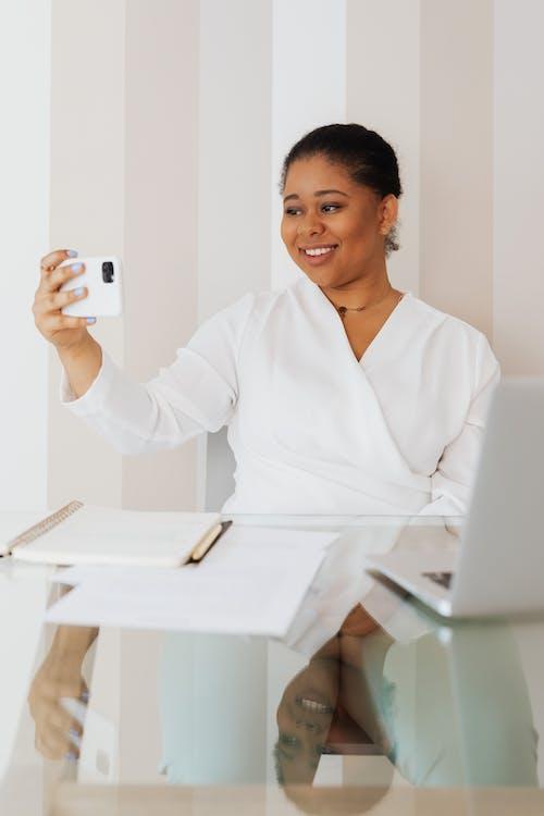 Woman in White Top Taking Selfie