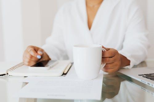 Person in White Top Holding White Ceramic Mug