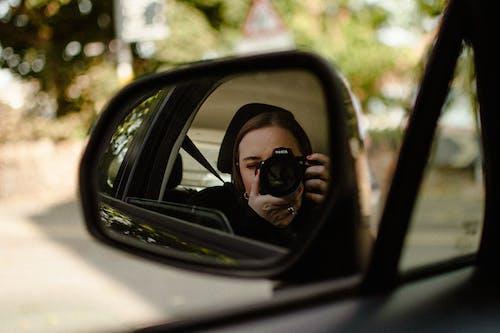 Man in Black Sunglasses Taking Selfie in Car Side Mirror