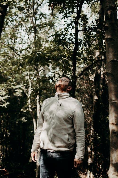 Man in Gray Coat Standing Near Tree