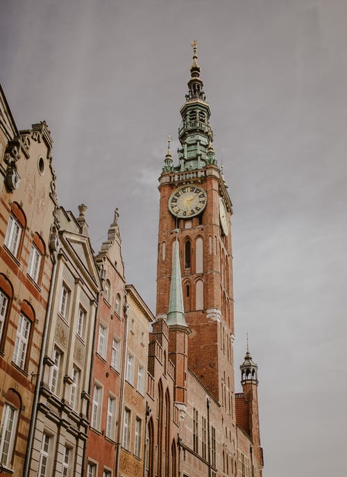 Clock tower of historical building against overcast sky