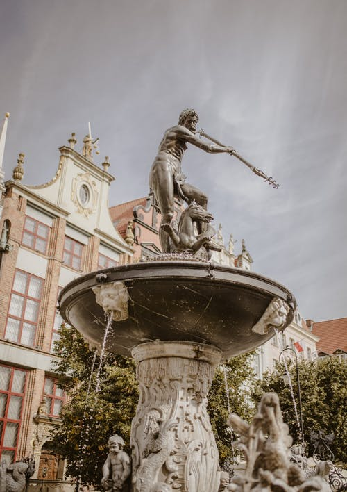 Sculptures and bas relief decorating ancient fountain located on city square