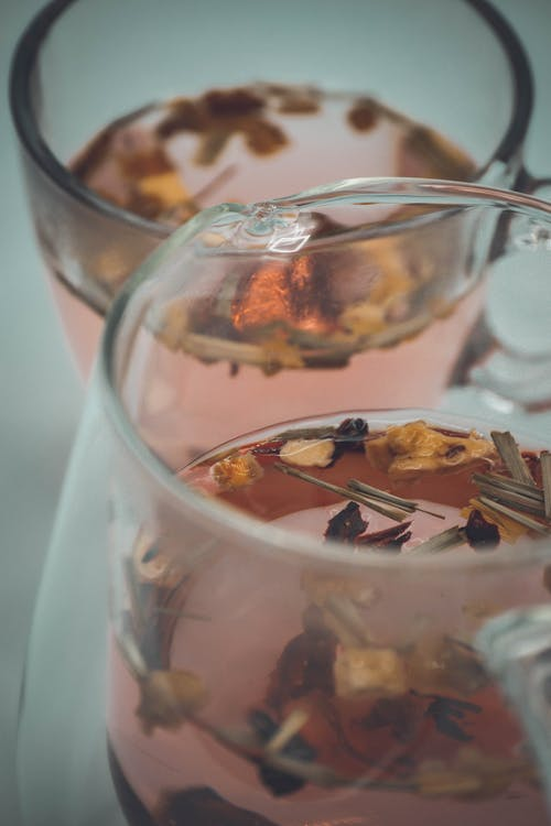 Glasses of hot tea with dried leaves