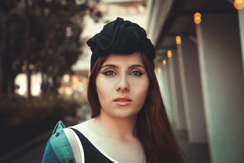 Shallow Focus Photo of a Beautiful Woman with Black Headwear