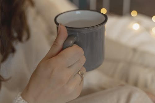 Close-Up View of a Person Holding Mug