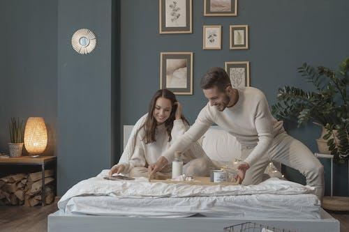 A Man Serving Breakfast in Bed