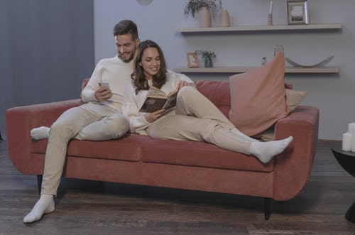 A Happy Couple Sitting on a Couch