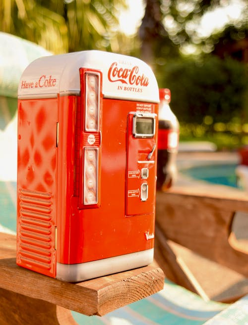 Shallow Focus Photo of a Coca-cola V39 Vending Machine
