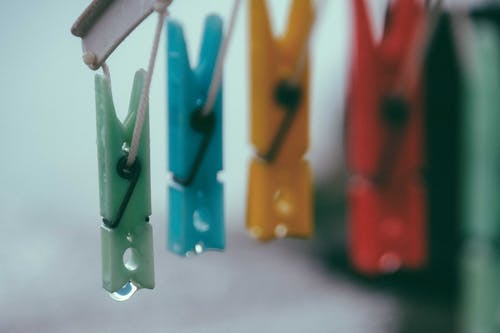 Colorful clothes pins on ropes