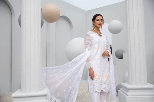 A Beautiful Woman in White Dress