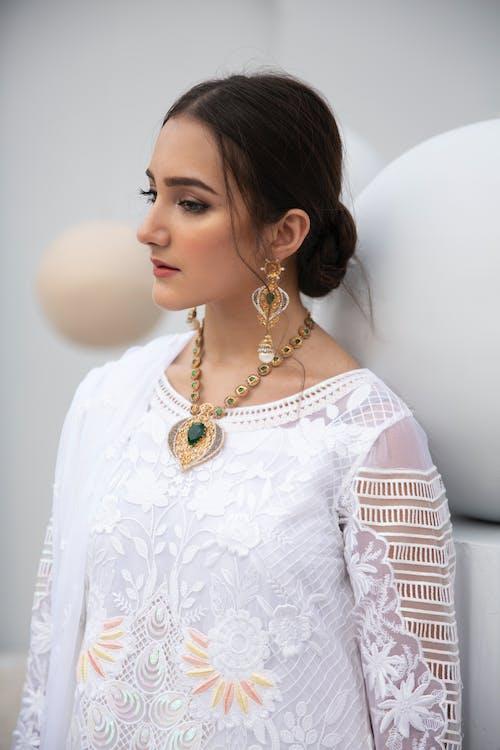 A Beautiful Woman in White Lace Dress