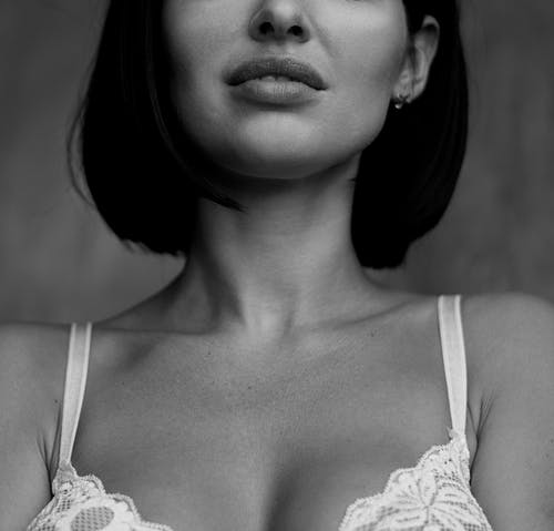 Close-Up Photo of a Woman in White Floral Brassiere