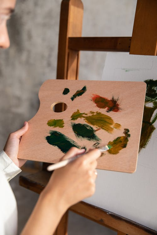 A Painter Holding a Wooden Palette