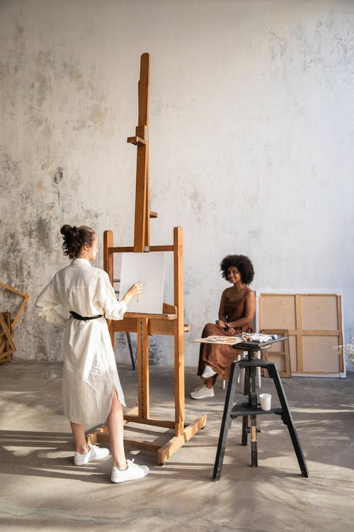 Painter Painting a Woman